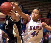 Kansas' Aquanita Burras (44) tries to steal a rebound from Colorado's Sabrina Scott. KU fell, 71-50, on Saturday at Allen Fieldhouse.