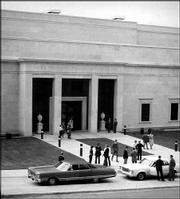 "Patrons gather outside Kansas University&squot;s Helen Foresman Spencer Museum of Art for the museum&squot;s grand opening gala on Jan. 17, 1978. In his inaugural address, Seymour Slive, then-director of Harvard University&squot;s Fogg Art Museum, called the Spencer ""a gem of a museum."" The Spencer celebrates its 25th birthday this year."