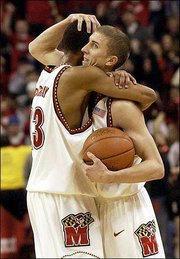 Maryland's Steve Blake, right, and teammate Chris McCray celebrate an 87-72 victory over Duke. The No. 17 Terrapins stunned the top-ranked Blue Devils on Saturday in College Park, Md.