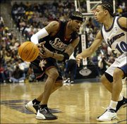 Philadelphia's allen Iverson, left, loses the ball as Washington's Tyronn Lue defends. The Sixers defeated the Wizards, 88-80, Saturday night in Washington.