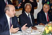 Russian Foreign Minister Igor Ivanov, left, speaks during a U.N. luncheon as United Nations Secretary-General Kofi Annan, center, and U.S. Secretary of State Colin Powell listen. Participants of a Security Council meeting of foreign ministers attended the lunch Monday.