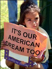 Vianney Rubio, 5, of Santa Ana, Calif., holds a sign at a rally to protest the arrests of Hispanic immigrant workers at Southern California airports, Aug. 23, 2002, in Santa Ana. Hispanics have surpassed blacks as the nation's largest minority group, the Census Bureau said Tuesday. The Latino population grew to 37 million in July 2001, up 4.7 percent from April 2000. The black population increased 2 percent during the same period to 36.1 million.