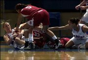 Kansas University guard Leila Mengüç, left, wrestles with Oklahoma defenders Maria Villarroel (5) and Laura Andrews (33) for a loose ball as KU's Tamara Ransburg, right, looks on. The Sooners beat the Jayhawks 61-49 on Wednesday at Allen Fieldhouse.