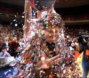 Texas coach Jody Conradt is doused with a bucket of confetti by Texas player Stacy Stephens. The 17th-ranked Longhorns upended No. 7 Texas Tech, 69-58, Wednesday night in Austin, Texas, to give Conradt her 800th career victory.