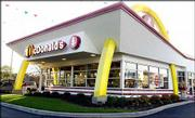 A federal judge on Wednesday dismissed a class-action lawsuit filed on behalf of children who claimed McDonald's food caused them to suffer health problems, including obesity. The retro McDonald's above is in Hinsdale, Ill. According to a McDonald's Web site, a Big Mac packs 590 calories and 34 grams of fat, while a large order of french fries has 540 calories and 26 grams of fat.