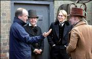 "Filmmaker Douglas McGrath, left, discusses a scene with actors Tom Courtenay, Charlie Hunnam and Kevin McKidd on the set of ""Nicholas Nickleby."""