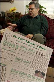Wayne Richardson of Lawrence is promoting a calendar that he believes is a better way to measure weeks and months than our traditional calendar. He displayed a poster version of his 2003 Kanasa Calendar on Wednesday.