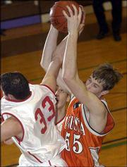 Ottawa's Andrew Maxwell, left, and Augusta's Kevin Schauf battle for a rebound in the Baldwin Invitational championship game. Augusta won the title Saturday, 62-58.