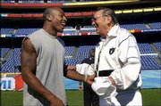 Oakland Raiders owner Al Davis, right, greets cornerback Terrance Shaw as the Raiders enter Qualcomm Stadium in San Diego. The Raiders had a walk-through practice Saturday.