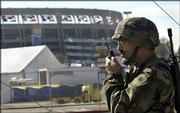 CPl. Bill Doke of the California National Guard patrols outside Qualcomm Stadium. Security is expected to be tight for Super Bowl XXXVII today at San Diego.