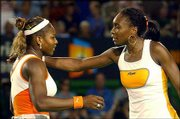 Serena Williams, left, accepts congratulations from her sister, Venus, after winning the Australian Open.