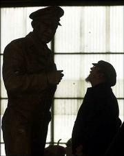 Sculptor Jim Brothers, right, looks over his statue of Gen. Dwight D. Eisenhower at the Heartland Art Bronze Foundry near Lawrence. The statue will replace one of former Kansas Gov. George Washington Glick in the National Statuary Hall Collection at the U.S. Capitol in Washington.