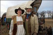 Ron and Teresa Dakotah, pictured with their covered wagon, make camp Thursday west of Perry.