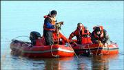 Members of the search and rescue team, from left, Sgt. Wes Houk of the Douglas County Sheriff's Office, and Capt. Allen Johnson, Lt. Robin Donahey and Earl Barnes of Lawrence-Douglas County Fire & Medical work with a diver looking to recover a stolen car in the Kansas River. Because of low rainfall this year, the river's level was low enough for the sunken vehicle to become visible; it was recovered Jan. 21.
