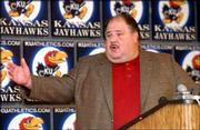 Kansas University football coach Mark Mangino addresses the media. Mangino announced 26 signees Wednesday at Hadl Auditorium.