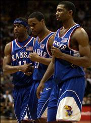 KU guard Michael Lee is flanked by fellow sophomores Aaron Miles, left, and Keith Langford on his way to the free-throw line at Colorado. Lee has shown a knack for clutch foul shooting in recent games.