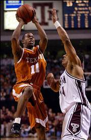 Texas guard T.J. Ford (11) goes up for a shot over Texas A&M's Bradley Jackson. Ford finished with 19 points, nine assists and six rebounds in the third-ranked Longhorns' 95-87 victory Saturday in College Station, Texas.