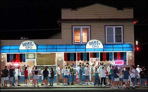 KU alumni miss doughnuts from Joe's Bakery, according to an informal poll by the Journal-World and the KU Alumni Association. In this file photo, students form a late-night line at the shop at 616 W. Ninth St.