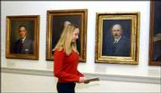 Kansas University freshman Callie Knoll walks past portraits of former KU chancellors to a meeting in her role of chancellor for the day. Knoll, Omaha, Neb., was selected in a Student Senate voter registration drawing. She and KU Chancellor Robert Hemenway switched responsibilities Monday.