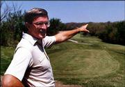 Standing behind Nelson and Judy Krueger's Lawrence home in 1987, Bob Billings discusses the Alvamar Golf Course and talks about plans for the future. Alvamar developer Billings died Thursday at his Lawrence home after an illness.