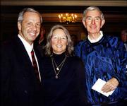 Kansas University basketball coach Roy Williams and his wife, Wanda, join Bob Billings during a January 2002 event to honor Billings and his many contributions to KU. The event was at KU's Adams Alumni Center.