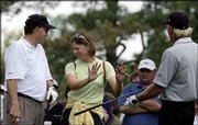 LPGA golfer Annika Sorenstam refuses a club offered by Greg Norman, right, as Raymond Floyd, left, watches during practice for the 2002 Masters at Augusta National Golf Club. Sorenstam said Thursday she might consider playing in more PGA Tour events depending on how she does at the Colonial.
