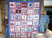 Jan Hartzler, in striped sweater, Shawnee, displays the Jayhawks quilt she made for her parents, Bill and Carolie Hougland of Lawrence. Bill Hougland played basketball for Kansas University, and 10 members of the family have attended KU, including all five of Bill and Carolie's children. The quilt, which is made of T-shirts and digital pictures printed on cloth, was a Christmas present. Carolie Hougland submitted the picture.