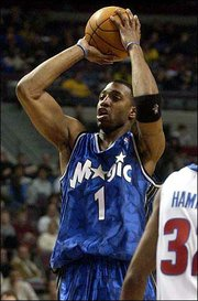 Orlando&#39;s Tracy McGrady sinks two of his 35 points. The Pistons