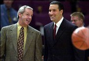 Kansas University coach Roy Williams, left, and UCLA's Steve Lavin chat before their Coaches Vs. Cancer Classic game to open the 2000-2001 season. Lavin is expected to be fired at the end of this season, and there is speculation the Bruins might make a run at Williams to fill the vacancy.