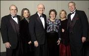 From left, Kansas University Medical Center Executive Vice Chancellor Don Hagen and his wife, Karen, join KU Chancellor Robert Hemenway and his wife, Leah, and Sherry Bohl and her husband, KU athletic director Al Bohl, at the 2003 Rock Chalk Ball at the Overland Park Convention Center and Sheraton Hotel. The black-tie event, which was Feb. 7, raised money to recruit and retain National Merit Scholars at Kansas University.