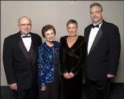 From left are Lawrence City Commissioner Jim Henry and his wife, Kay Henry, retiring senior vice president of the Kansas University Alumni Association, and Sandy Wellman and her husband, Mike Wellman, director of Internet services at the Alumni Association. The couples attended the Rock Chalk Ball Feb. 7 at the Overland Park Convention Center and Sheraton Hotel.