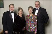 Pictured during Rock Chalk Ball 2003 are, from left, Dale Seuferling, president of the Kansas University Endowment Association; his wife, Marianne Seuferling; Linda Williams and her husband, Fred Williams, president of the Kansas University Alumni Association. The event featured cocktails, a silent and live auction, Scholars Salute, dinner and dancing.