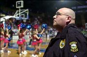 Sgt. James Anguiana, of the Kansas University Public Safety Office, surveys the crowd at Allen Fieldhouse during a basketball game. Security at the fieldhouse includes sweeps before games, searches of fans and more officers on duty during events.