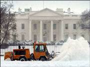 Workers clear snow in front of the White House in Washington, D.C. The most extreme winter weather in recent years hit the nation's capital Sunday.