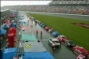 NASCAR Winston cup cars are lined up on pit road as it rains during the Daytona 500. Sunday's race was cut short by inclement weather, with Michael Waltrip winning after just 109 of 200 laps were completed at the Daytona International Speedway in Daytona Beach, Fla.