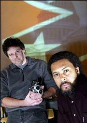 "Lawrence-based director Kevin Willmott, right, and cinematographer Matt Jacobson, both assistant professors in theatre and film at KU, have completed ""C.S.A. -- The Confederate States of America."" The movie is a mock documentary of what might have happened to America if the South had won the Civil War."