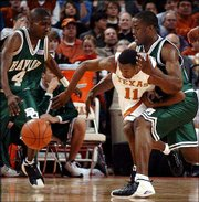 Baylor's Ellis Kidd Jr., left, and Terrance Thomas, right, battle Texas' T.J. Ford for a loose ball. The Longhorns won, 82-64, Wednesday in Austin, Texas.