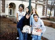 Volunteers for a newspaper recycling program at Central Junior High School display some of their efforts outside the school. Back row, from left, are Brianna Nelson-Overs, 14, daughter of Cindy Nelson; Thai Pongmee, 15, daughter of Laura and Yudthana Pongmee; and Mahleea Satomi, 15, daughter of Robert Rose. Front row, from left, are Kelsie Reyes, 15, daughter of Yolanda and Tiburcio Reyes; and Michelle Conley, 15, daughter of Gilda and Johnny Beane. The girls gather and carry newspapers to the curb weekly in a recycling effort started by Central's library and student council. Got a shot for Friends & Neighbors? Send it, along with your name, phone number and caption information, to Friends & Neighbors, P.O. Box 888, Lawrence 66044.