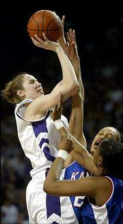 Kansas State's Nicole Ohlde, left, shoots over a pair of Kansas defenders in the Wildcats' 80-57 victory. K-State routed the Jayhawks Wednesday in Manhattan.