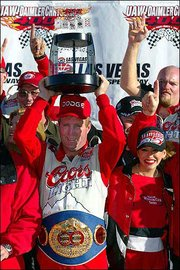 Sterling Marlin celebrates his victory in the 2002 UAW-DaimlerChrysler 400 at Las Vegas.