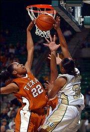 Texas' Nina Norman, left, blocks the shot of Baylor's Ebony Jackson. The Longhorns won, 79-57, Wednesday in Waco, Texas.