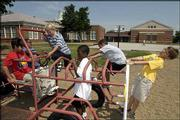 Enrollment in Lawrence's center-city neighborhood elementary schools like Centennial, Schwegler and New York, shown here, has been on a decline as it has increased in schools on the city's fringe. Pictured at the New York School playground in this file photo are, from left, Jonathan Luna, 10, Stephen Obiefule, 9, Nathan Jalali, 8, Caleb Walker, 9, Nate Davis, 9, and Nolan Whipple, 8.