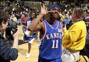 Kansas University's Aaron Miles, above, gestures to the Missouri