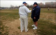 The start of spring football drills at Kansas University brings together former KU coach Don Fambrough and current Jayhawk coach Mark Mangino in this 2003 file photo.