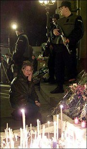 A woman lights a candle for slain Serbian prime minister Zoran Djindjic in front of Serbia's government building in Belgrade. Djindjic was assassinated Wednesday.