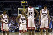 Arizona players, from left, Salim Stoudamire, Jason Gardner, Channing Frye and Rick Anderson stand on the court in the final minute of their loss. The top-ranked Wildcats were knocked off by UCLA, 96-89, in overtime in the first round of the Pac-10 Conference tournament Thursday in Los Angeles.