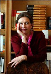 "Author Louise Erdrich poses in Birchbark Books, the bookstore she owns in south Minneapolis. Erdrich explores her European roots in her newest book, ""The Master Butchers Singing Club."""