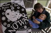 Lawrence artist Lora Jost created a piece of art advocating peace and printed the image onto postcards. The art was inspired by a moment shared with her 11-month-old son, Nicholai.