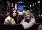Mary Valentis, a University at Albany English professor, left, and Capital Repertory Theater artistic director Maggie Mancinelli-Cahill pose at the theater in Albany, N.Y. The two are working on The Technology Play Project, which updates an ancient dramatic form by staging plays through contemporary devices like computers.