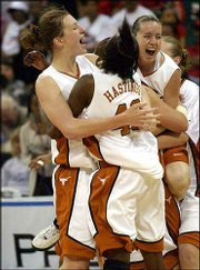 Texas' Heather Schreiber, left, Annissa Hastings (43) and Jamie Carey, right, celebrate their Big 12 Conference tournament title. The fifth-ranked Longhorns held off No. 8 Texas Tech, 67-57, in the championship game Saturday night in Dallas.